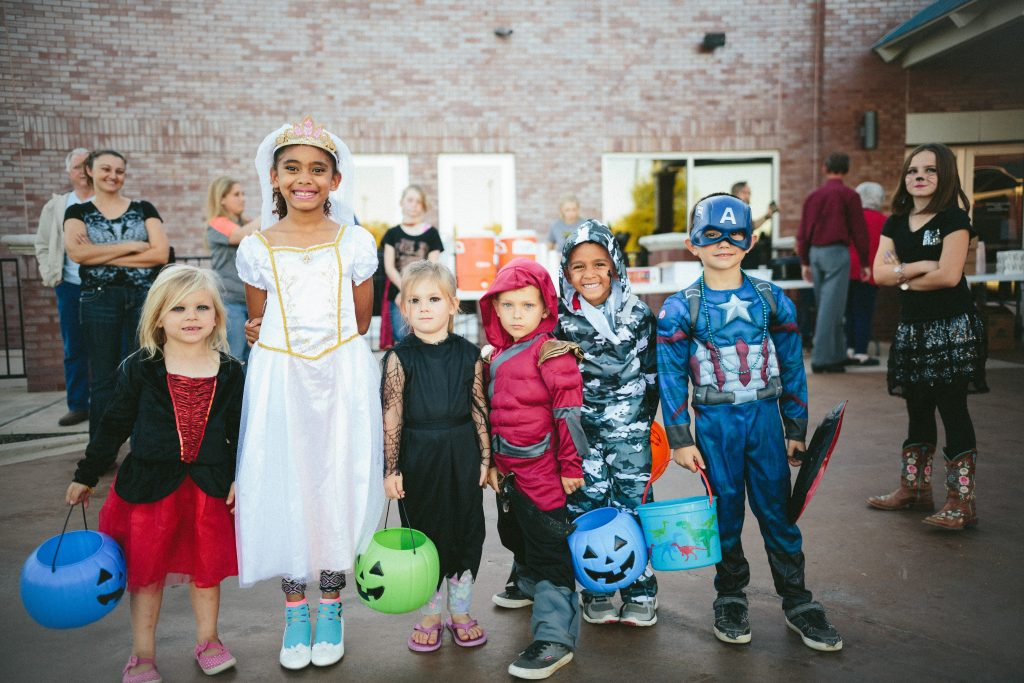 Children saving energy this Halloween by sharing costumes